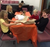 Children-enjoyed-designing-their-own-paper-pumpkin-at-the-Harvest-Festival-to-take-home.