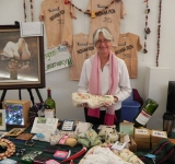 Cindy-Rogers-brought-a-variety-of-items-from-the-Evergreen-Conservancy-to-sale-at-the-Bazaar