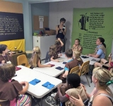 The RE summer program focused on Jedi Training. With teacher, Liz Cook, shown instructing, students leaned to master skills- sewing, gardening, meditation, singing, and Tai Chi.