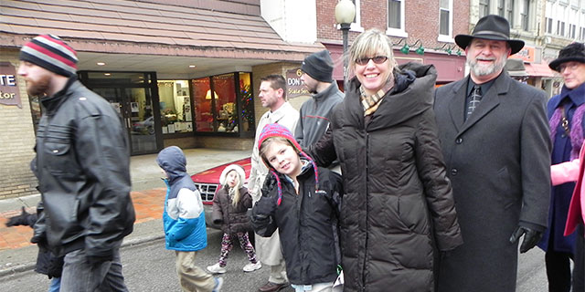 Anne McGowan and son, Connor were at the front of the MLK March.