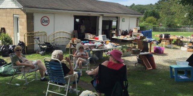 A huge number of donations were  made to sale.  Shown are Lois Young, Sandy Whitson, Nonna Randal, and Faye Bradwick.