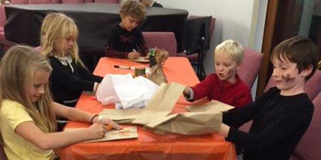 Children enjoyed designing their own paper pumpkin at the Harvest Festival to take home.