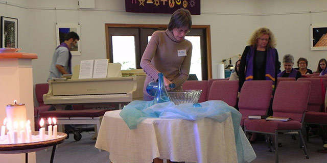 First UU member, Tina Perdue, added water representing her travel to Spain.