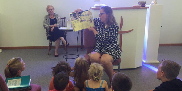 Religious Education Director, Penny Vick, read the final Dr. Seuss book during the Story for All Ages before inviting all members to the Dr. Seussebration in the RE room.