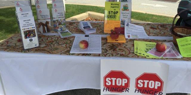 Visitors to the Farmer's Market Community Tent were able to pick up information concerning First UU.